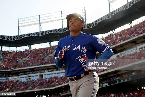 Ezequiel Carrera of the Toronto Blue Jays celebrates after scoring a run off of a double hit by Josh Donaldson against Cole Hamels of the Texas...
