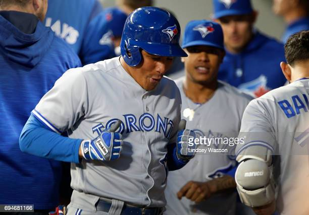 Ezequiel Carrera of the Toronto Blue Jays celebrates his home run in the eighth inning off of Mariners pitcher Tony Zych at Safeco Field on June 10...