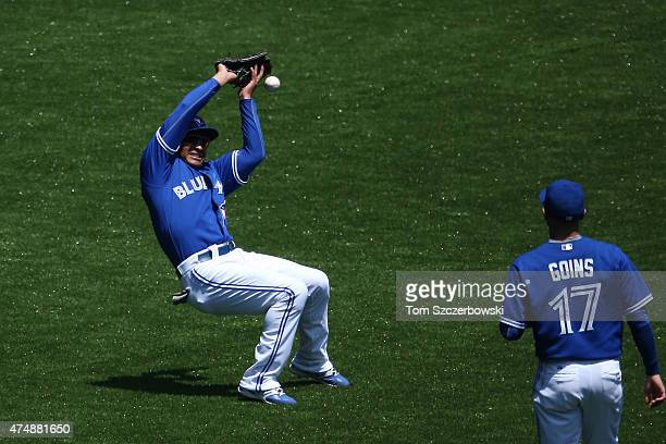 Ezequiel Carrera of the Toronto Blue Jays drops a fly ball in the third inning leading to a run during MLB game action against the Chicago White Sox...