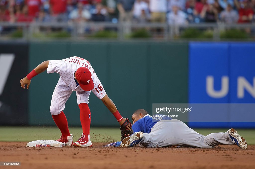 Ezequiel Carrera #3 of the Toronto Blue Jays is tagged out at second base by Cesar Hernandez #16 of the Philadelphia Phillies in the third inning during a game at Citizens Bank Park on June 15, 2016 in Philadelphia, Pennsylvania.