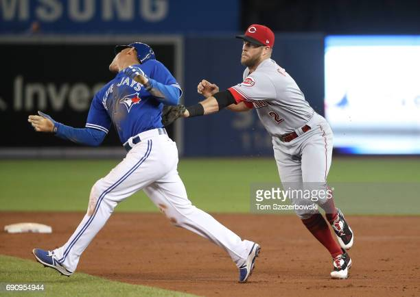 Ezequiel Carrera of the Toronto Blue Jays is tagged out by Patrick Kivlehan as he is caught in a rundown in the third inning during MLB game action...