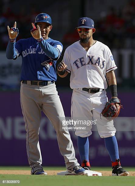 Ezequiel Carrera of the Toronto Blue Jays reacts from third base against the Texas Rangers during the third inning in game one of the American League...