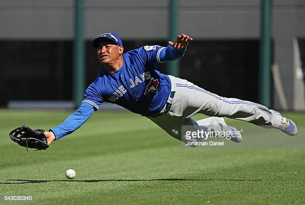 Ezequiel Carrera of the Toronto Blue Jays tries unsuccessfully to make a catch on a ball hit by Jose Abreu of the Chicago White Sox in the 9th inning...