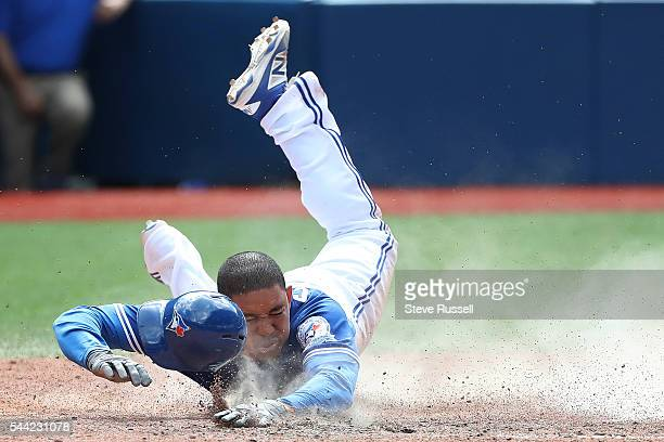 TORONTO ON JULY 2 Ezequiel Carrera slides home for the winning run as the Toronto Blue Jays beat the Cleveland Indians 96 to end their 14 game...