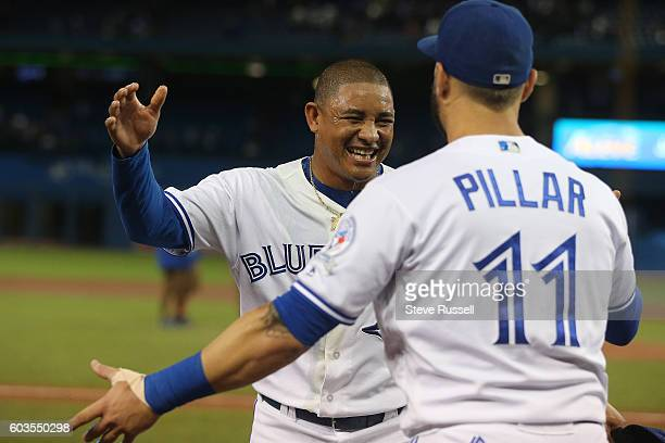 TORONTO ON SEPTEMBER 12 Ezequiel Carrera who hit the game winning home run hugs Kevin Pillar after aPowerade shower as the Toronto Blue Jays beat the...