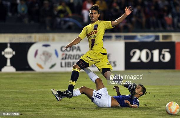 Ezequiel Filippeto of Bolivia's Universitario de Sucre vies for the ball with De Arrascaeta of Brazil's Cruzeiro during their Libertadores Cup...