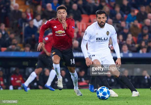 Ezequiel Garay defender of Valencia CF competes for the ball with Jesse Lingard forward of Manchester United FC during the UEFA Champions League...
