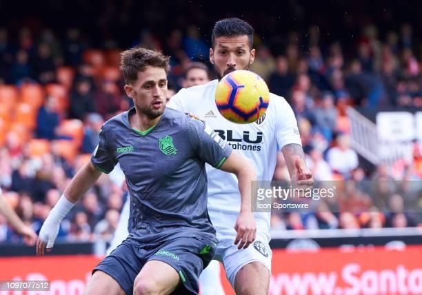Ezequiel Garay defender of Valencia CF competes for the ball with Adnan Januzaj midfielder of Real Sociedad during the La Liga match between Valencia...