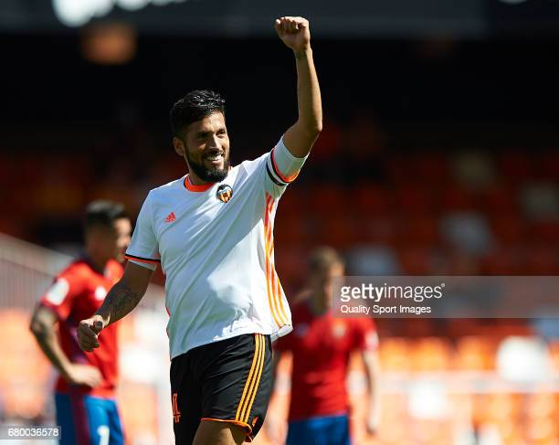 Ezequiel Garay of Valencia celebrates after scoring the first goal during the La Liga match between Valencia CF and CA Osasuna at Mestalla Stadium on...