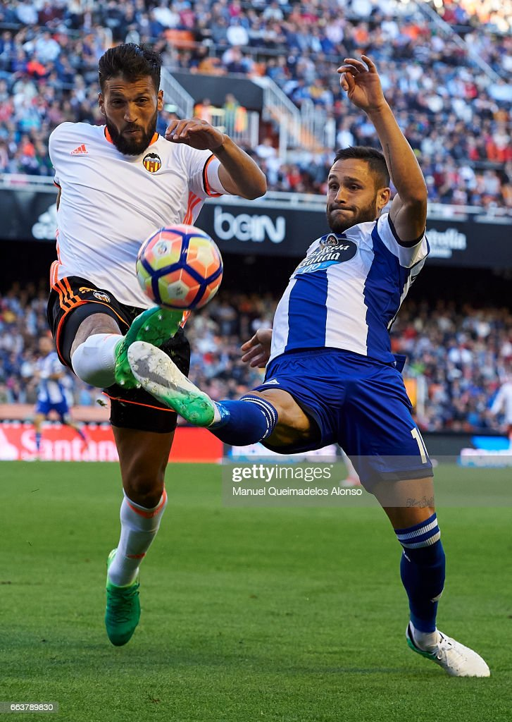 Ezequiel Garay (L) of Valencia competes for the ball with Florin Andone of Deportivo de La Coruna during the La Liga match between Valencia CF and Deportivo de La Coruna at Mestalla Stadium on April 2, 2017 in Valencia, Spain.