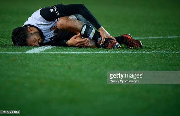 Ezequiel Garay of Valencia lies on the pitch during the La Liga match between Valencia and Villarreal at Mestalla Stadium on December 23 2017 in...