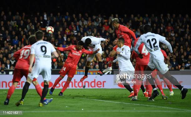 Ezequiel Garay of Valencia scores his side's second goal during the La Liga match between Valencia CF and Real Madrid CF at Estadio Mestalla on April...