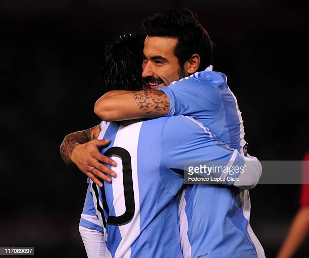 Ezequiel Lavezzi and Lionel Messi of Argentina celebrate a goal against Albania during a friendly match at Monumental Vespucio liberti on June 20,...