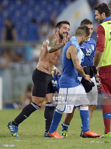 Ezequiel Lavezzi of Argentina and Lorenzo Insigne of Italy after the international friendly match between Italy v Argentina at Stadio Olimpico on...