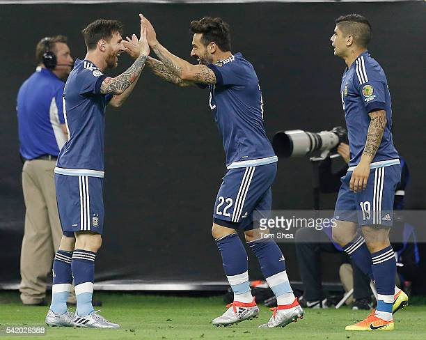 Ezequiel Lavezzi of Argentina celebrate with teammate Lionel Messi after scoring the opening goal during the Semifinal match between United States...