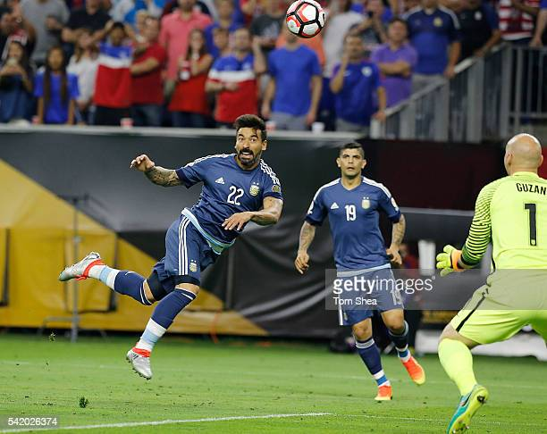 Ezequiel Lavezzi of Argentina heads the ball to score the opening goal during the Semifinal match between United States and Argentina at NRG Stadium...