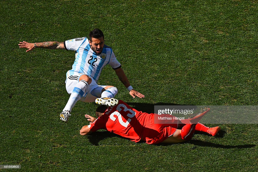 Ezequiel Lavezzi of Argentina is challenged by Xherdan Shaqiri of Switzerland during the 2014 FIFA World Cup Brazil Round of 16 match between Argentina and Switzerland at Arena de Sao Paulo on July 1, 2014 in Sao Paulo, Brazil.