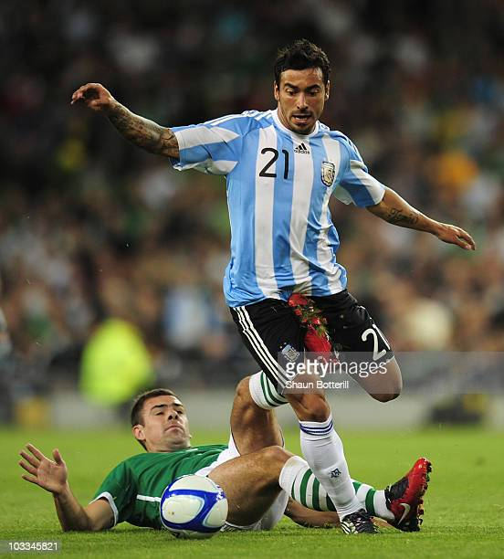 Ezequiel Lavezzi of Argentina is tackled by Darron Gibson of Republic of Ireland during the International Friendly match between Republic of Ireland...