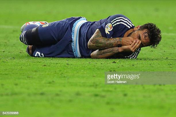 Ezequiel Lavezzi of Argentina reacts after being hit in the face in the first half against the United States during a 2016 Copa America Centenario...