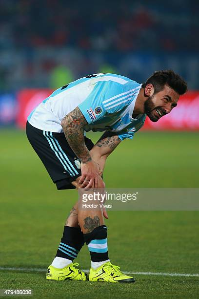 Ezequiel Lavezzi of Argentina reacts after being injuried during the 2015 Copa America Chile Final match between Chile and Argentina at Nacional...