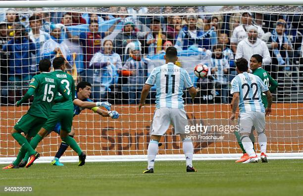 Ezequiel Lavezzi of Argentina scores the second goal of his team a Quarterfinal match between Argentina and Bolivia at CenturyLink Field as part of...