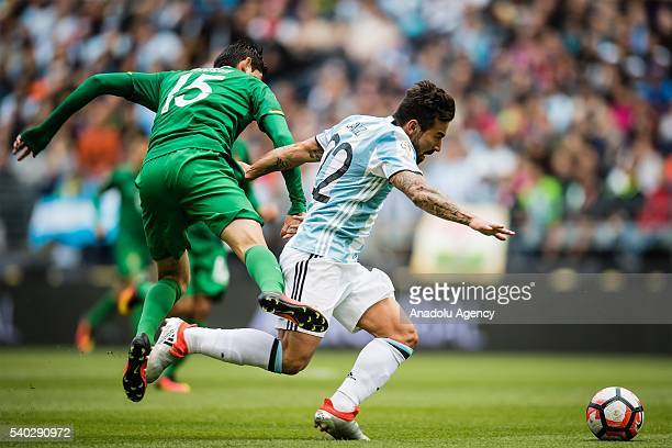 Ezequiel Lavezzi of Argentina struggles for the ball against Pedro Azogue of Bolivia during the 2016 Copa America Centenario Group D match between...