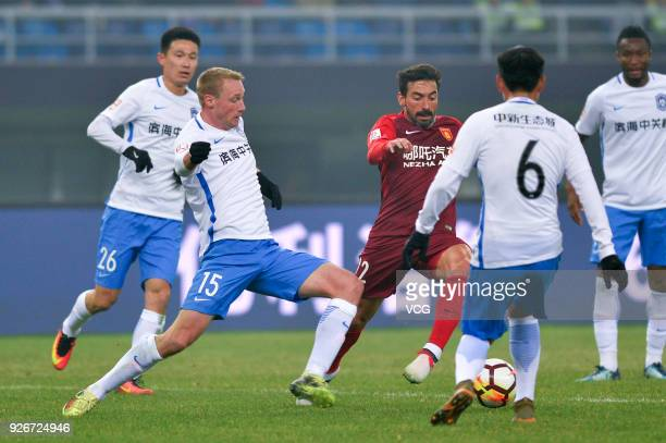 Ezequiel Lavezzi of Hebei China Fortune and Felix Bastians of Tianjin Teda compete for the ball during the 2018 Chinese Football Association Super...