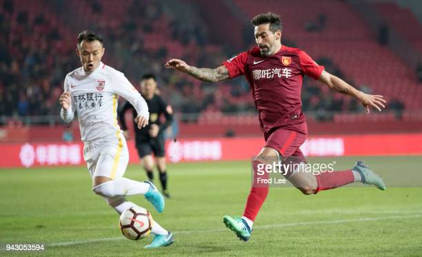 Ezequiel Lavezzi of Hebei China Fortune and Jiang Zhe of Changchun Yatai in action during the 2018 Chinese Super League match between Hebei China...