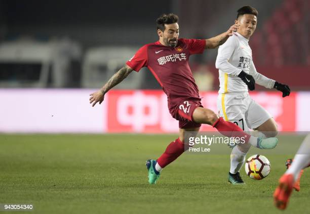 Ezequiel Lavezzi of Hebei China Fortune and Zhang Li of Changchun Yatai in action during the 2018 Chinese Super League match between Hebei China...