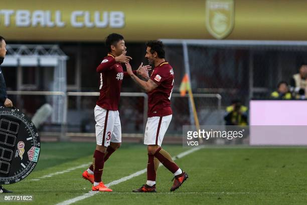 Ezequiel Lavezzi of Hebei China Fortune celebrates a point with teammate during the Chinese Super League match between Hebei China Fortune and...