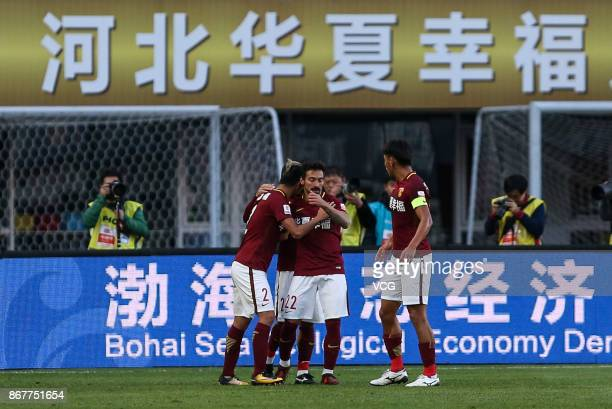 Ezequiel Lavezzi of Hebei China Fortune celebrates a point with teammates during the Chinese Super League match between Hebei China Fortune and...