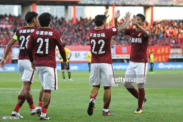 Ezequiel Lavezzi of Hebei China Fortune celebrates a point with Zhao Mingjian of Hebei China Fortune during the Chinese Super League match between...