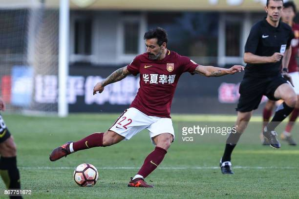 Ezequiel Lavezzi of Hebei China Fortune kicks the ball during the Chinese Super League match between Hebei China Fortune and Guangzhou Evergrande at...