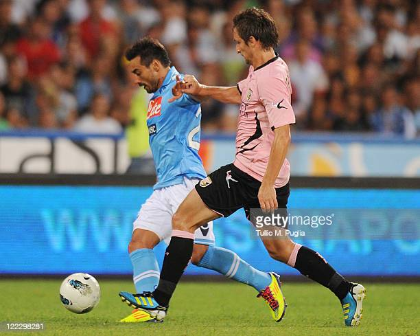 Ezequiel Lavezzi of Napoli and Armin Bacinovic of Palermo compete for the ball during the pre season friendly match between SSC Napoli and US Citta...