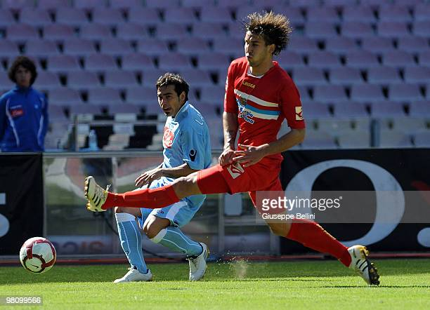 Ezequiel Lavezzi of Napoli and Blazes Augustyn of Catania in action during the Serie A match between SSC Napoli and Catania Calcio at Stadio San...