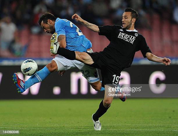 Ezequiel Lavezzi of Napoli and Claudio Terzi of Siena in action during the Serie A match between SSC Napoli and AC Siena at Stadio San Paolo on May...