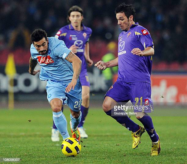 Ezequiel Lavezzi of Napoli and Gaetano D'Agostino of Fiorentina in action during the Serie A match between Napoli and Fiorentina at Stadio San Paolo...