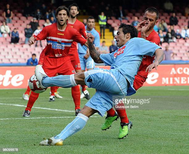 Ezequiel Lavezzi of Napoli and Giuseppe Mascara of Catania in action during the Serie A match between SSC Napoli and Catania Calcio at Stadio San...