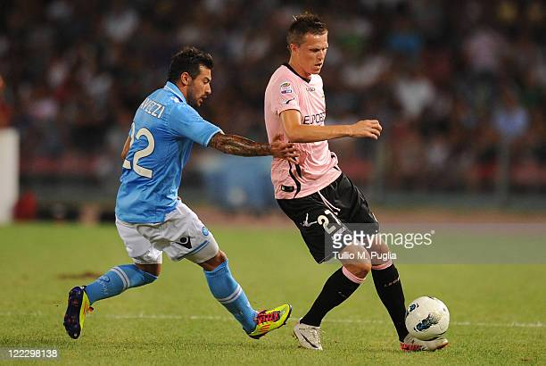 Ezequiel Lavezzi of Napoli and Josip Ilicic of Palermo compete for the ball during the pre season friendly match between SSC Napoli and US Citta di...