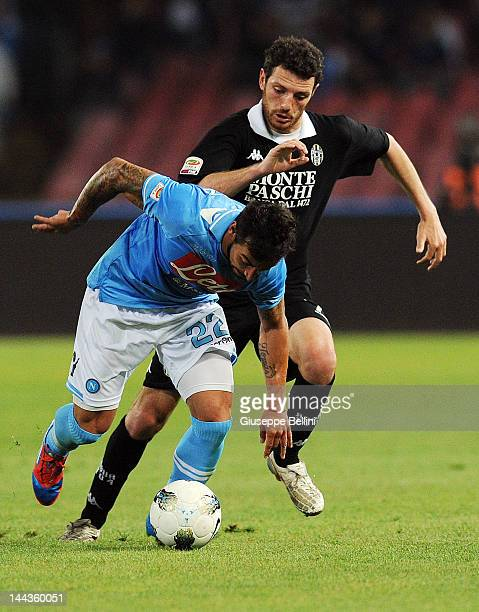 Ezequiel Lavezzi of Napoli and Luigi Giorgi of Siena in action during the Serie A match between SSC Napoli and AC Siena at Stadio San Paolo on May 13...