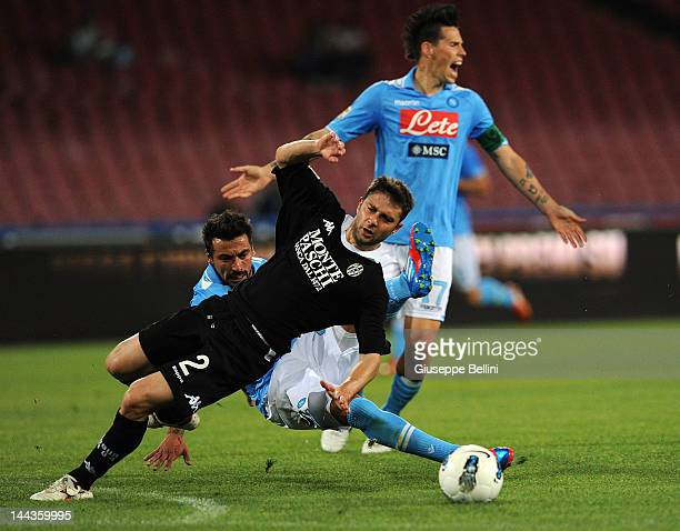 Ezequiel Lavezzi of Napoli and Roberto Vitiello of Siena in action during the Serie A match between SSC Napoli and AC Siena at Stadio San Paolo on...