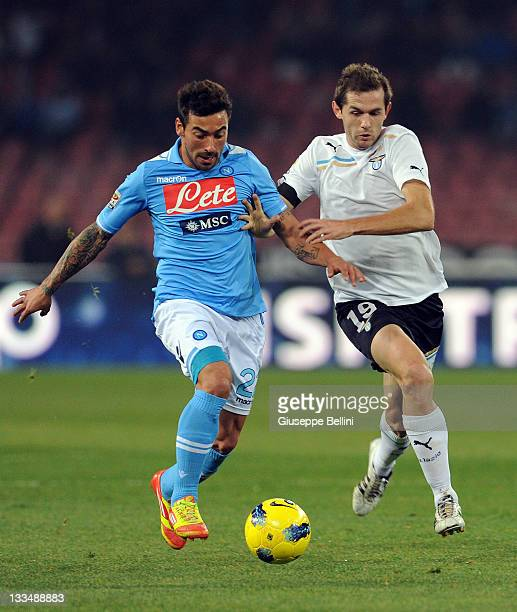Ezequiel Lavezzi of Napoli and Senad Lulic of Lazio in action during the Serie A match between SSC Napoli and SS Lazio at Stadio San Paolo on...