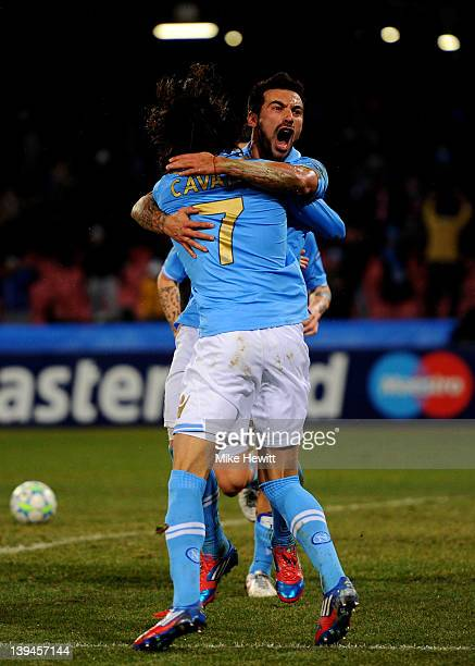 Ezequiel Lavezzi of Napoli celebrates with teammate Edinson Cavani after scoring his team's third goal during the UEFA Champions League round of 16...