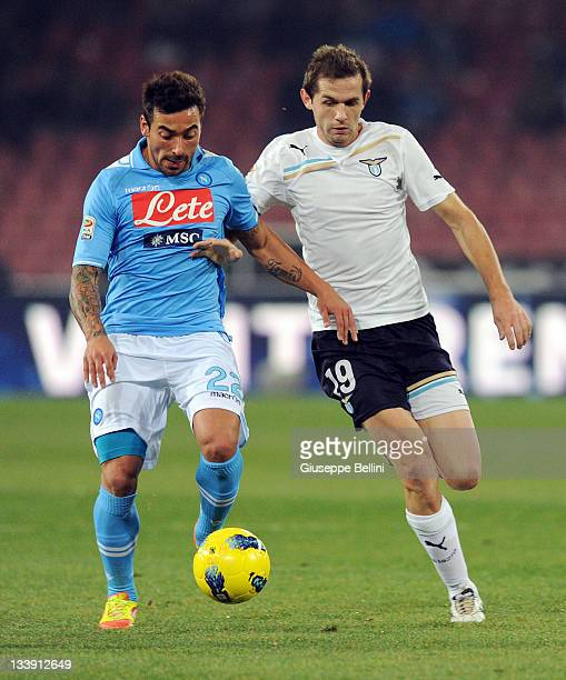 Ezequiel Lavezzi of Napoli is challenged by Senad Lulic of Lazio during the Serie A match between SSC Napoli and SS Lazio at Stadio San Paolo on...