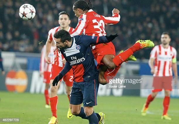 PARIS FRANCE NOVEMBER Ezequiel Lavezzi of Paris SaintGermain and Leandro Salino of Olympiacos FC during the UEFA Champions League between Paris...