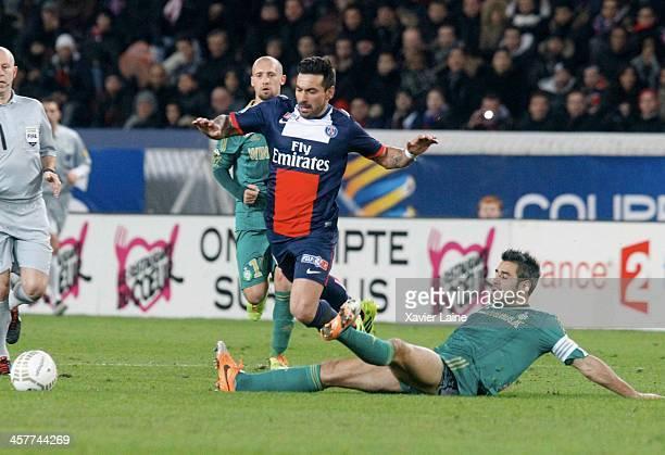 Ezequiel Lavezzi of Paris SaintGermain and Loic Perrin of SaintEtienne ASSE during the French Ligue Cup between Paris SaintGermain FC and...