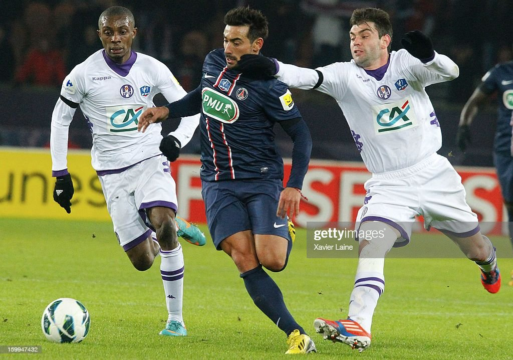 Ezequiel Lavezzi of Paris Saint-Germain FC battles for the ball during the French Cup between Paris Saint-Germain FC and Toulouse FC, at Parc des Princes on January 23, 2013 in Paris, France.