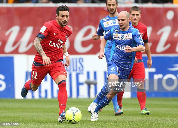 Ezequiel Lavezzi of PSG and Benjamin Nivet of Troyes in action during the Ligue 1 match between ES Troyes Aube Champagne ESTAC and Paris SaintGermain...