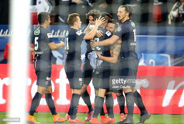 Ezequiel Lavezzi of PSG celebrates scoring the second goal for his team with teammates during the French Cup semifinal match between Paris...