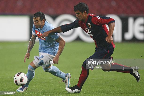 Ezequiel Lavezzi of SSC Napoli competes for the ball with Diego Polenta of Genoa CFC during the Serie A match between SSC Napoli and Genoa CFC at...